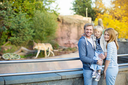 Family with little child in zoo Stock Photo