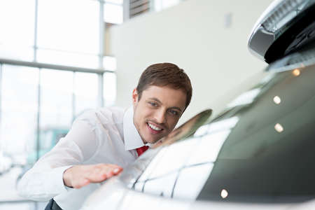 seller: Young seller with car Stock Photo