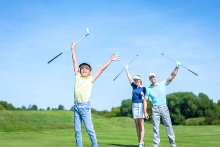 golf glove: Active family with child on the golf course