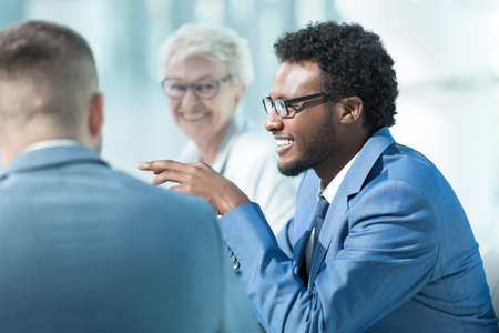 Smiling business people at meeting in office