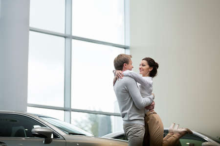 buying: Young couple buying cars