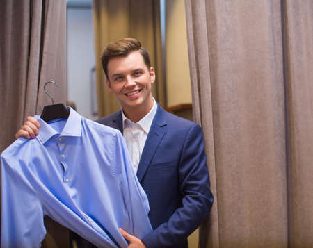 indoors: Smiling man with shirt indoors Stock Photo