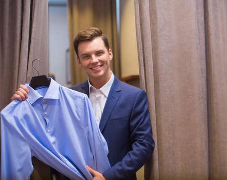 man shirt: Smiling man with shirt indoors Stock Photo