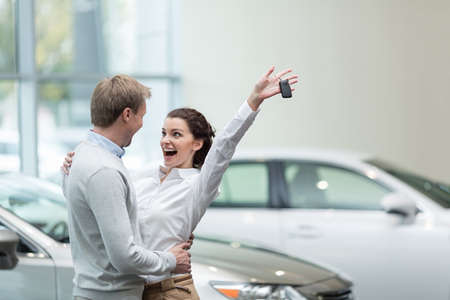 Embracing couple with car keys Stock Photo