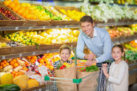 child boy: Father with children in a store Stock Photo