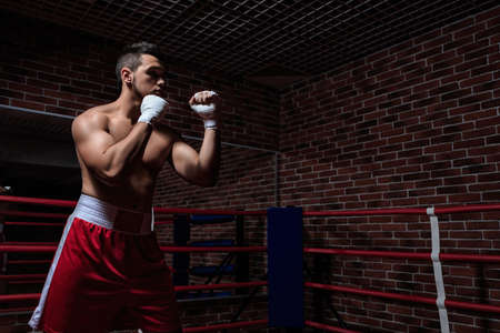 boxing sport: Sportsman in boxing ring Stock Photo