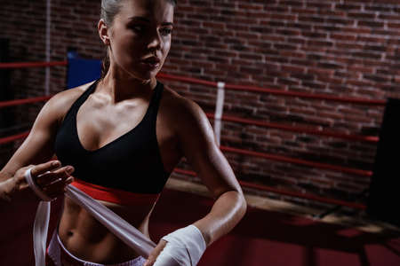 competitive sport: Attractive girl in boxing ring