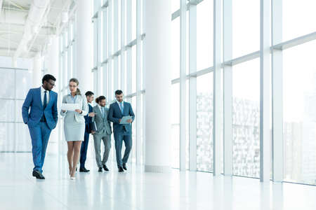 white window: Young people in office Stock Photo
