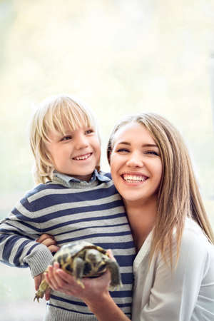 turtles love: Mother and son in zoo Stock Photo