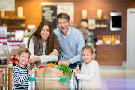 child boy: Family with child in a store