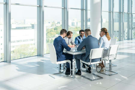 sitting man: Business people at meeting in office Stock Photo