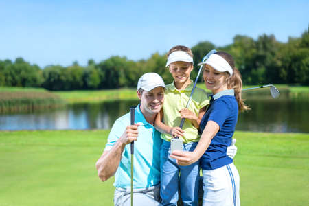 golf glove: Family with child on a golf course
