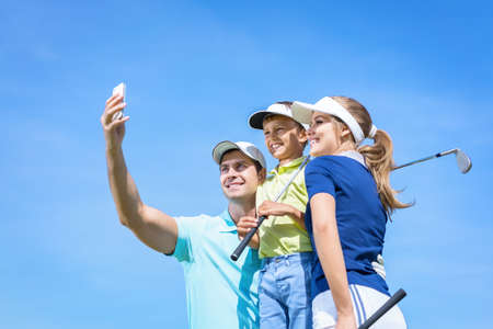Family with child making selfie photo