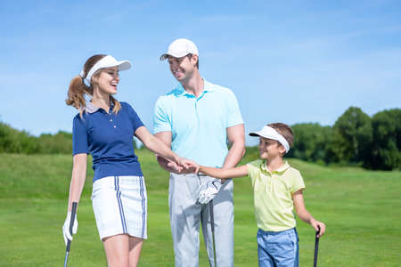 Family with child on a golf course photo