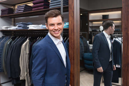 clothing shop: Smiling man in a store Stock Photo