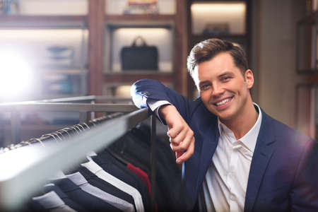 retail store: Smiling young man in store