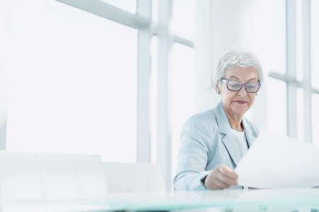 Senior woman with laptop photo