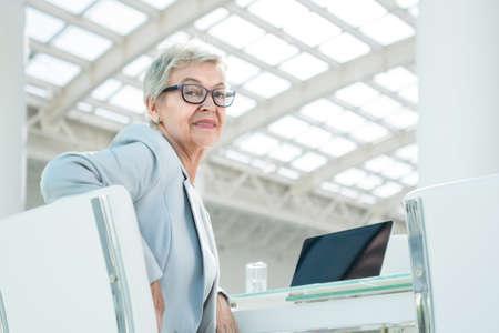 Elderly businesswoman in office photo