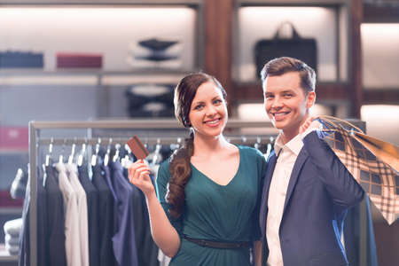shopping card: Young couple with credit card in shop Stock Photo