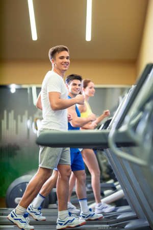 indoors: Active people at treadmill indoors Stock Photo