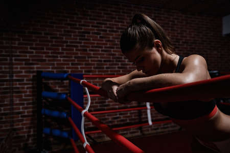 competitive sport: Young woman in boxing ring