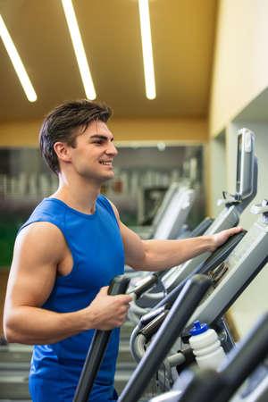 elliptical: Running man on elliptical Stock Photo