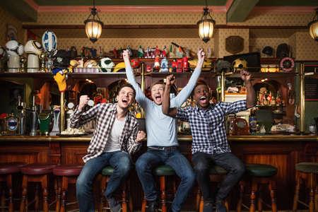 Expression fans at a bar Foto de archivo