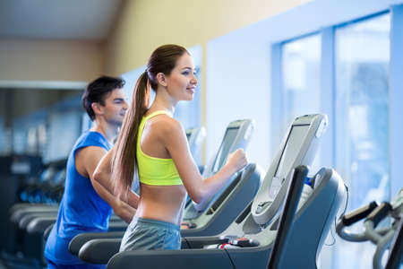 Young people on a treadmill Stock Photo