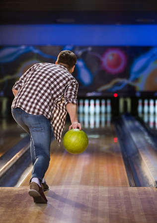 indoors: Active man playing bowling indoors Stock Photo