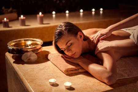 Young girl in spa massage