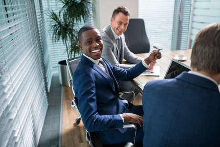 communications: Smiling business people in office