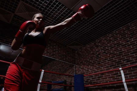 Young woman in boxing ring photo