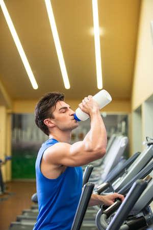 elliptical: Drinking sportsman at elliptical