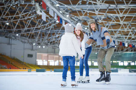 iceskating: Family at ice-skating rink