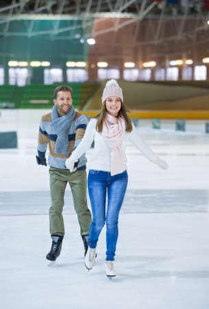 Active couple at skating rink