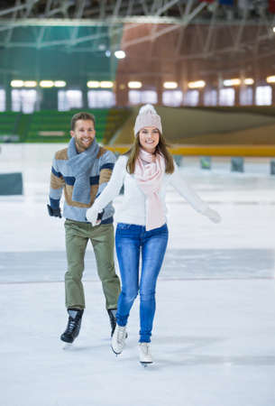 Active couple at skating rink