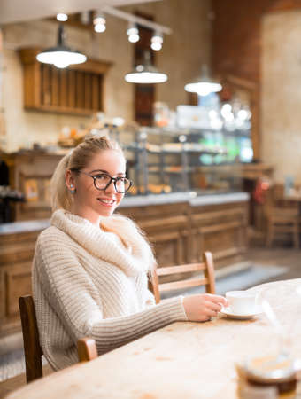 educations: Smiling student in bakery Stock Photo