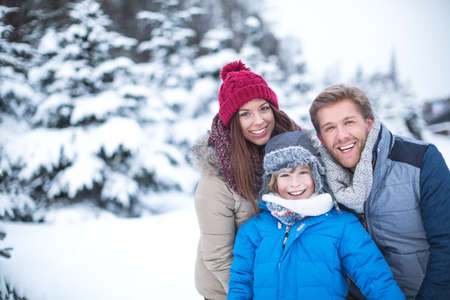 Family at winter forest Stock Photo