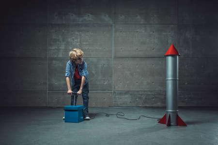Boy with detonate in studio Imagens