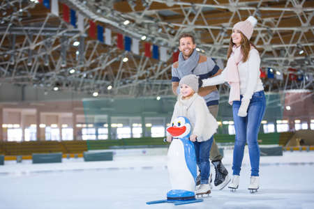 Family with child at ice-skating rink Stock Photo - 61122986