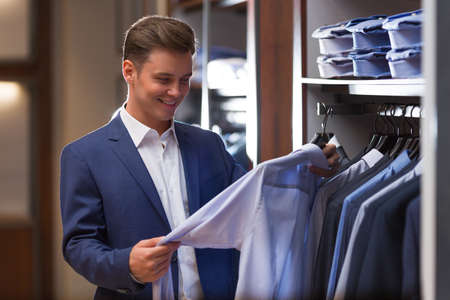 clothing shop: Young businessman in store