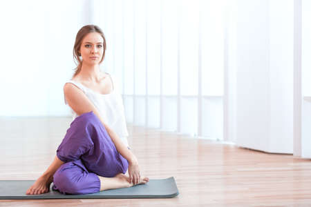 Caucasian woman: Young woman in yoga position