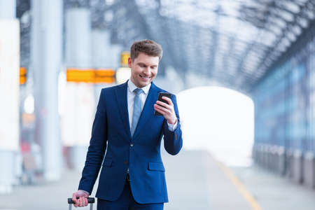 public transport: Young businessman with phone