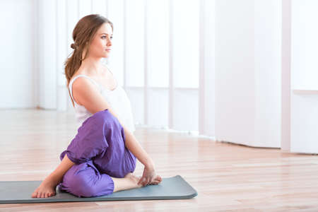 Young woman in yoga position