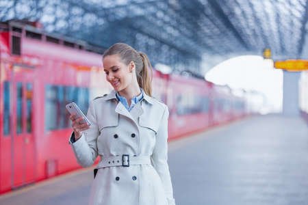 Smiling businesswoman with phone Stock Photo