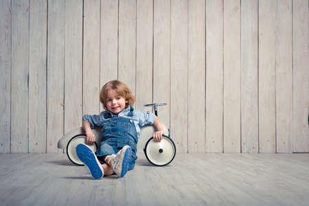 Little boy with car in studio Foto de archivo