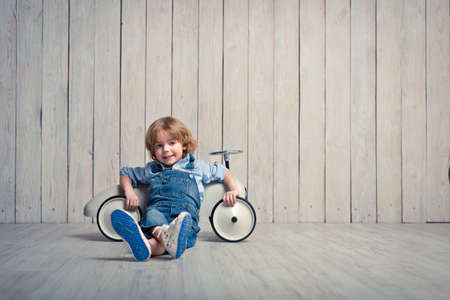 Little boy with car in studio Stockfoto