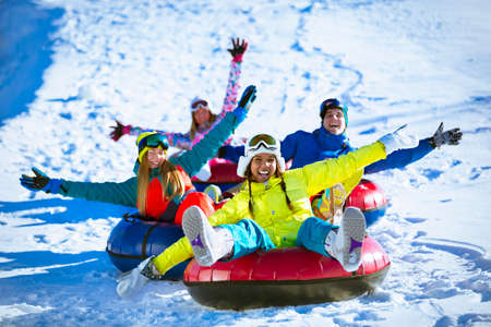 Happy people on a tube outdoors Banque d'images