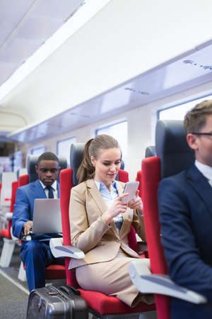 woman business suit: Business people in a train Stock Photo