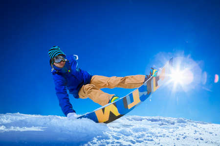 Active man with snowboard outdoors